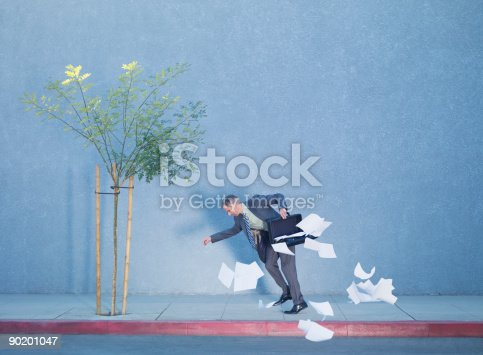 istock Businessman dropping papers from briefcase 90201047