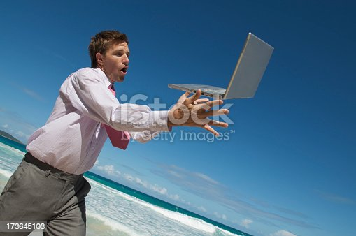 istock Businessman Drops or Catches Laptop 173645103