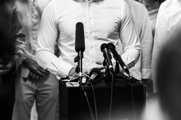 Businessman during press conference stock photo