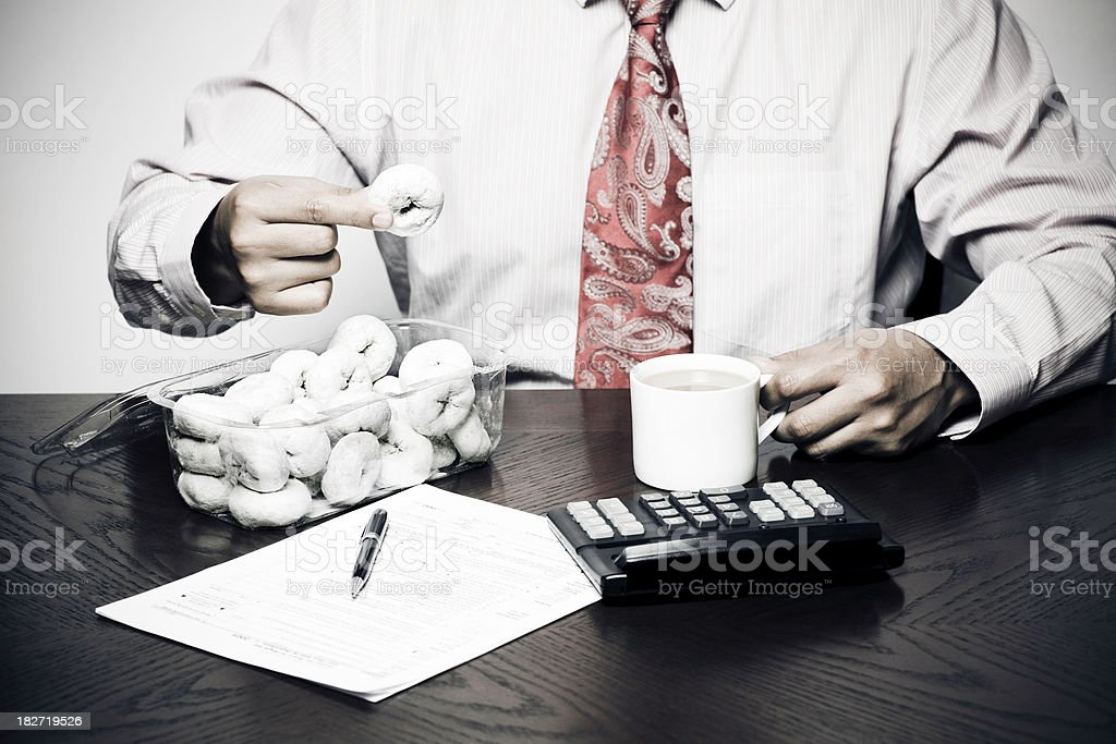 businessman eating donuts and coffee stock photo