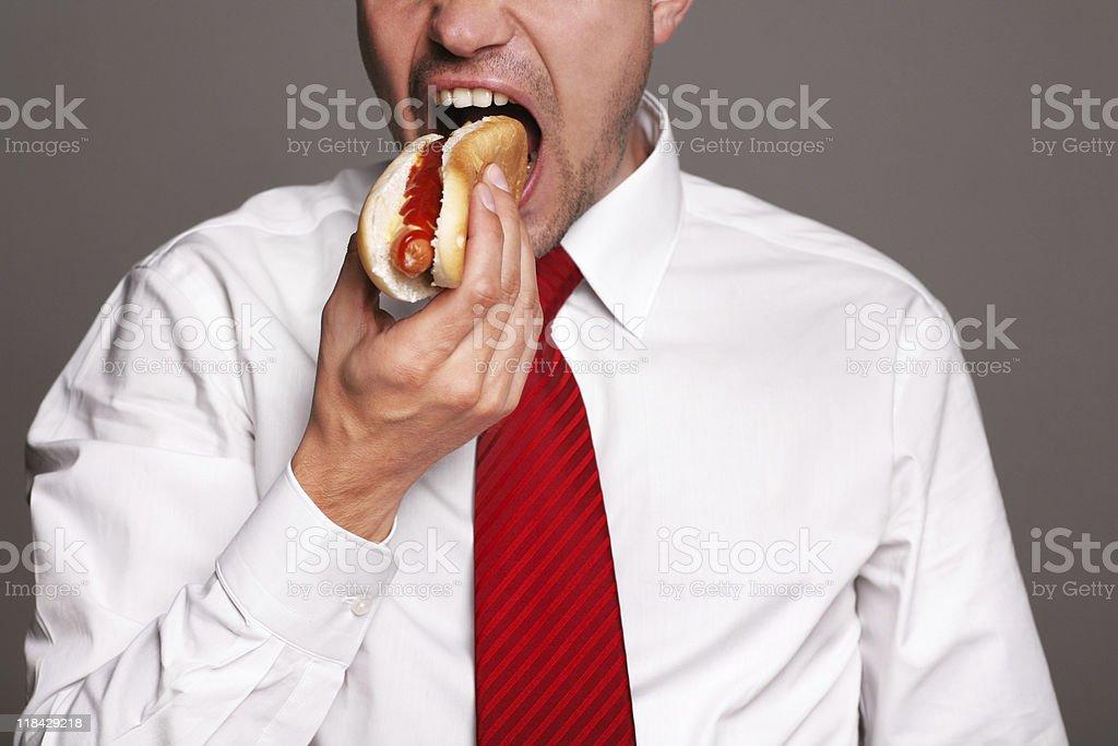 businessman  eating hot dog royalty-free stock photo