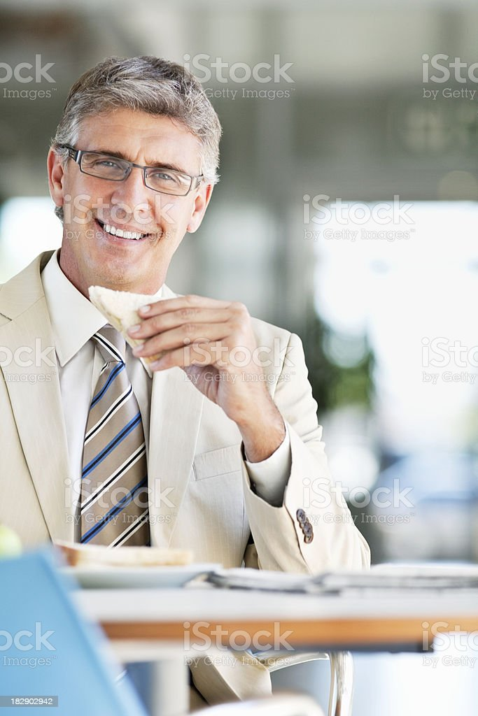 Businessman Eating Lunch royalty-free stock photo