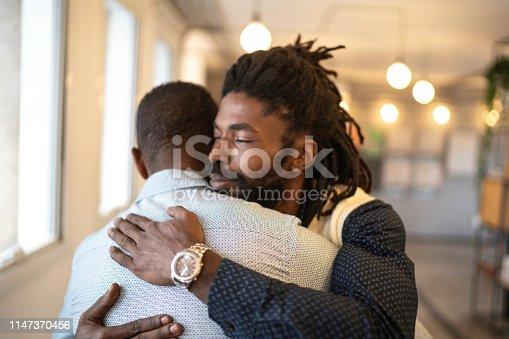 Businessman embracing celebrating good news