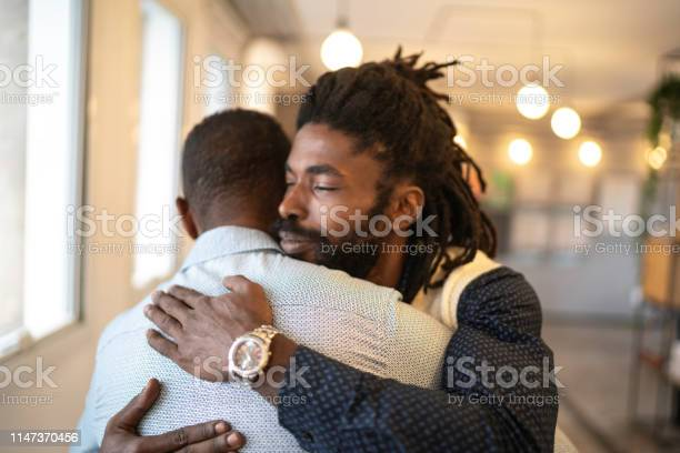Businessman Embracing Celebrating Good News Stock Photo - Download Image Now