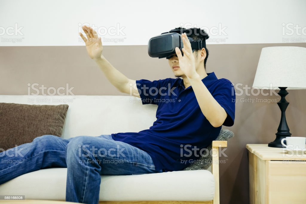 Businessman enjoy VR indoors stock photo