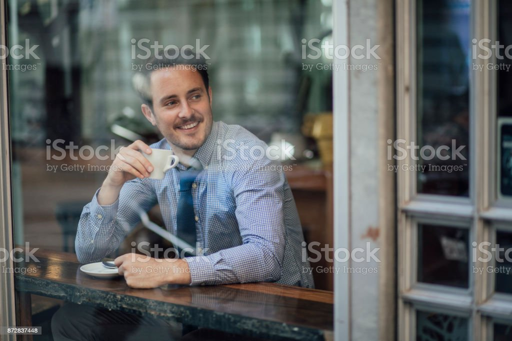 Businessman Enjoying A Coffee Before Work stock photo