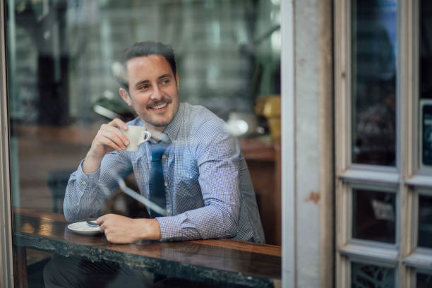 businessman enjoying a coffee before work - day in the life series stock pictures, royalty-free photos & images