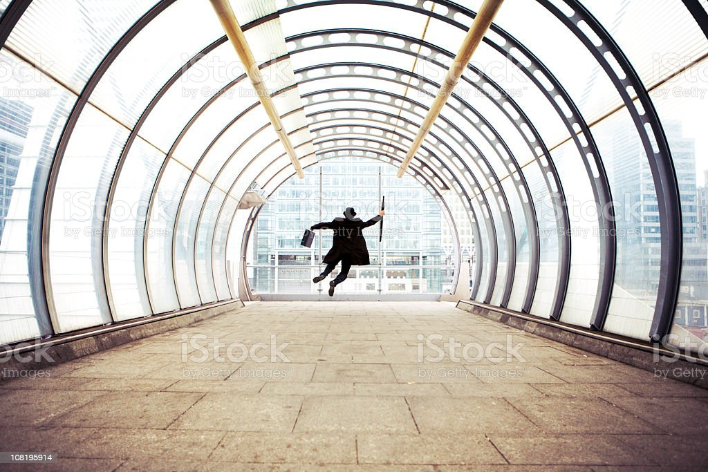 Businessman enjoying his success on building hallway stock photo