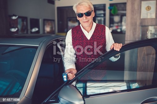 1138561232 istock photo Businessman enjoying new car 914571696