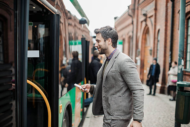 businessman entering a bus - getting on stock photos and pictures