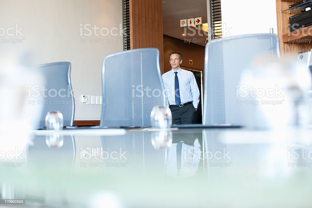 Businessman entering conference room royalty-free stock photo