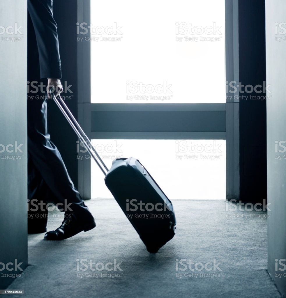 Businessman entering in a hotel room royalty-free stock photo