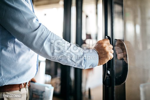 Businessman opening door entering office cabin