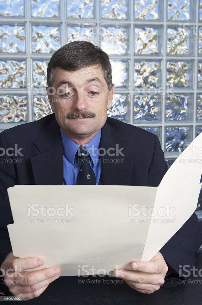 Businessman Examining a File royalty-free stock photo