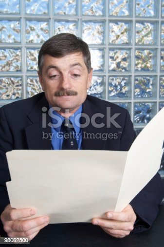 Businessman Examining A File Stock Photo & More Pictures of 40-49 Years