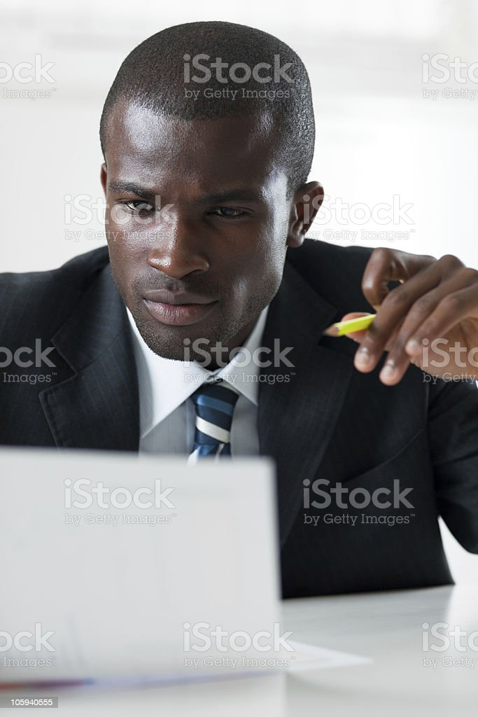 businessman examining documents stock photo