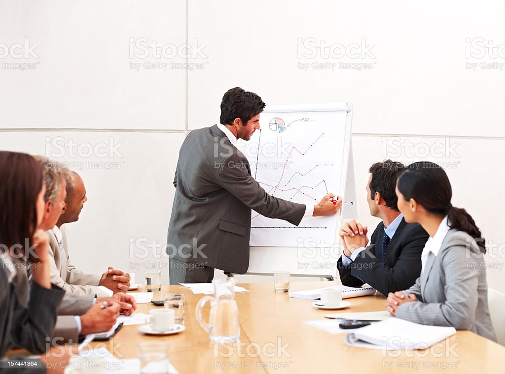 Businessman explaining chart to his colleague at meeting royalty-free stock photo
