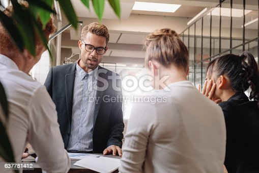 istock Businessman explaining new business strategy to colleagues 637781412