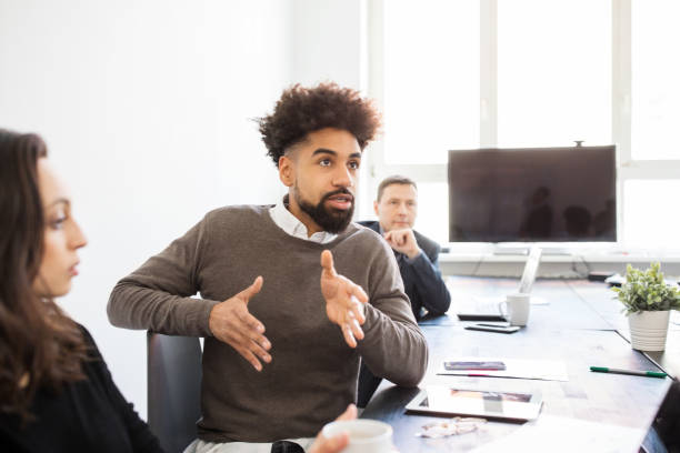 Businessman explaining new strategy during meeting stock photo