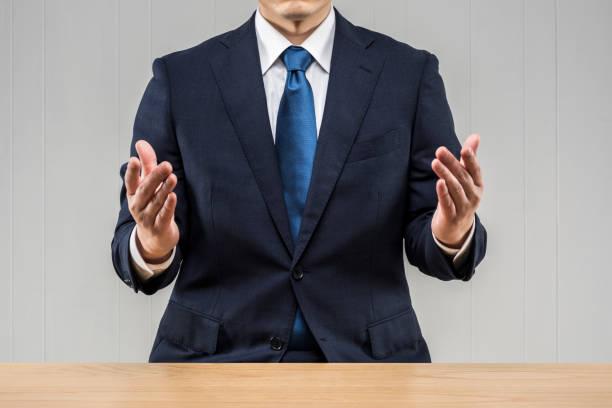 説明するビジネスマン - よそいきの服 ストックフォトと画像