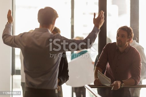 istock Businessman explaining strategy to colleagues 1126818614