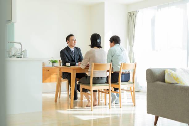 Businessman explaining to middle aged couple stock photo