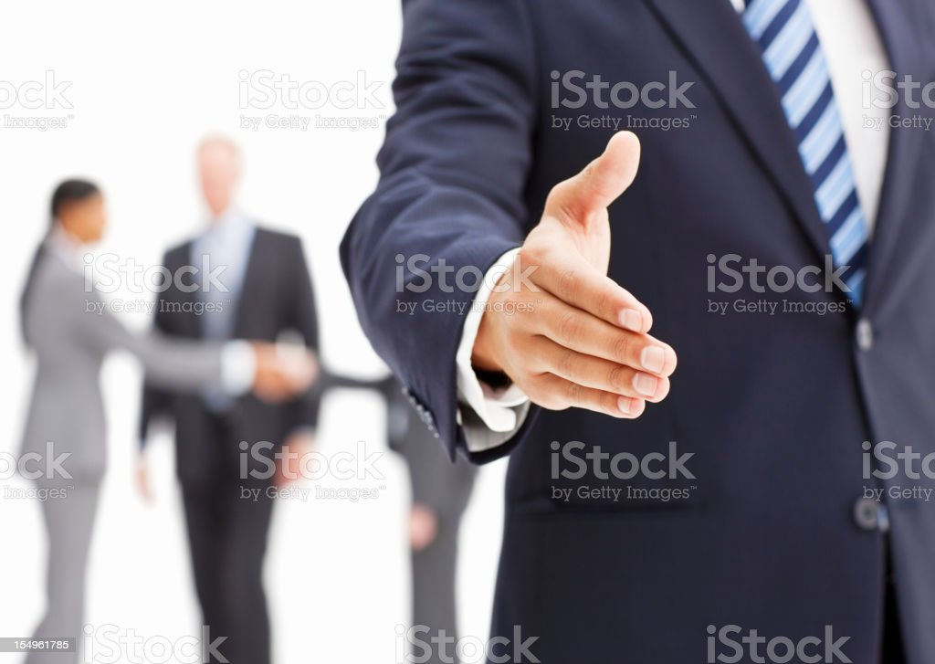 Businessman Extending a Hand In Greeting stock photo