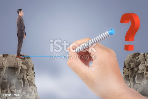 Personal development concept. Future success with risky challenge, Asian businessman standing at the edge of cliff, facing question mark across the gap, with big leader mentor helping to cross