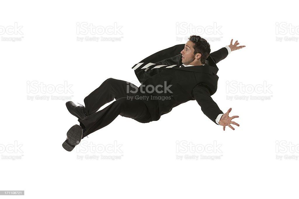 Businessman falling down stock photo