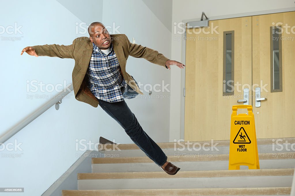 Businessman Falling on Stairwell stock photo