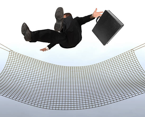 Businessman falling stock photo
