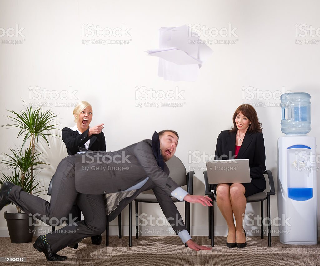businessman falls over stock photo