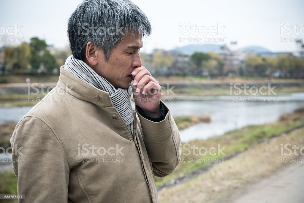 Businessman feeling bad by the river stock photo