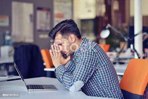 istock Businessman feeling headache while doing distance work in coffee shop tired with failure of plans 859157012