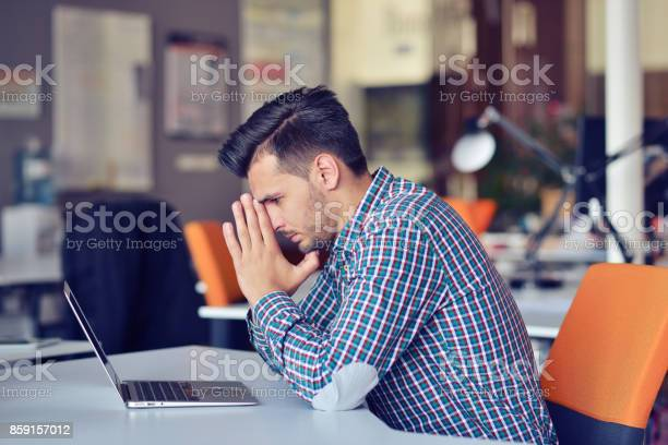 Businessman Feeling Headache While Doing Distance Work In Coffee Shop Tired With Failure Of Plans Stock Photo - Download Image Now
