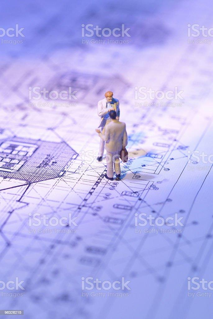 Businessman figure on the plan royalty-free stock photo
