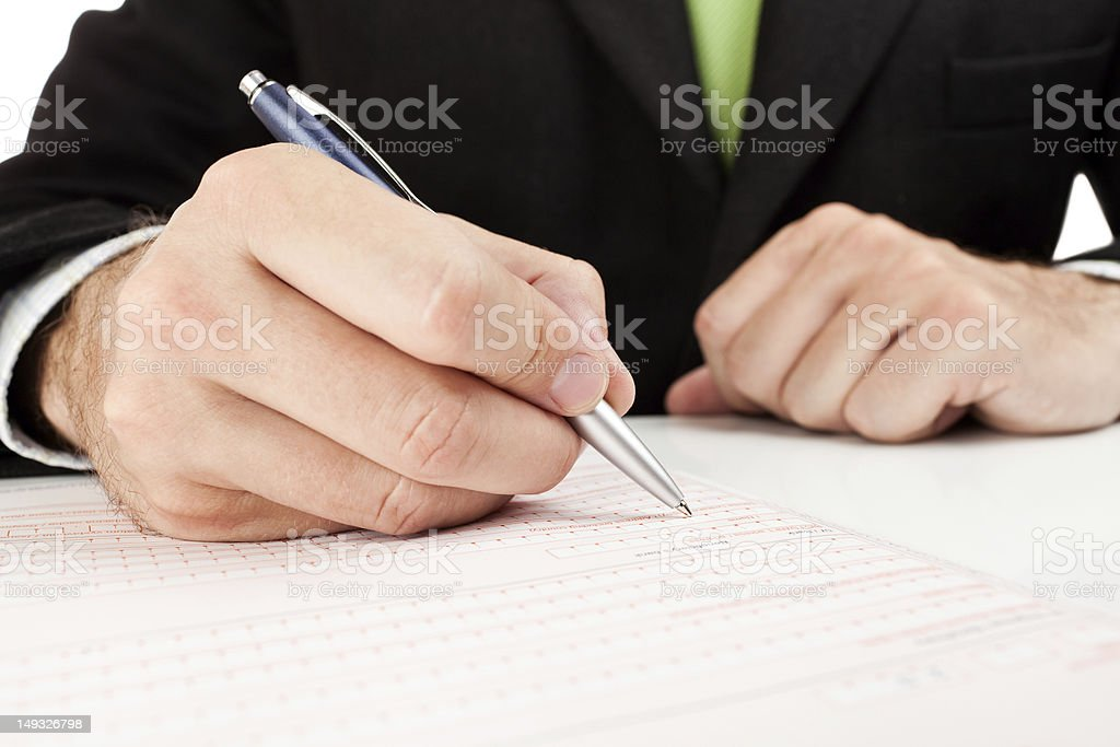 Businessman fills out a form. royalty-free stock photo