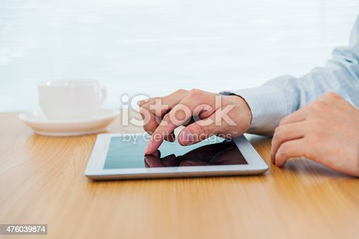 istock Businessman finger touching digital tablet 476039874