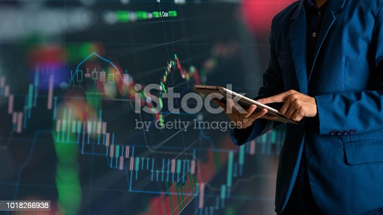 611747524istockphoto Businessman finger touching tablet with finance and banking profit graph of stock market trade indicator financial 1018266938