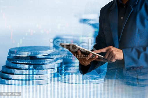 611747524istockphoto Businessman finger touching tablet with finance and banking profit graph of stock market trade indicator financial 1018522442