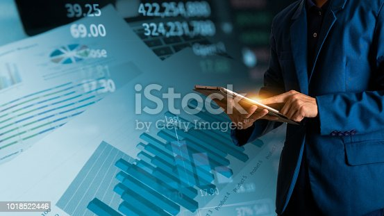 611747524istockphoto Businessman finger touching tablet with finance and banking profit graph of stock market trade indicator financial 1018522446