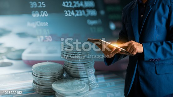 611747524istockphoto Businessman finger touching tablet with finance and banking profit graph of stock market trade indicator financial 1018522452