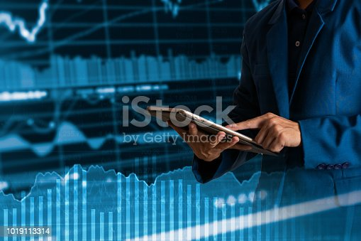 611747524istockphoto Businessman finger touching tablet with finance and banking profit graph of stock market trade indicator financial 1019113314