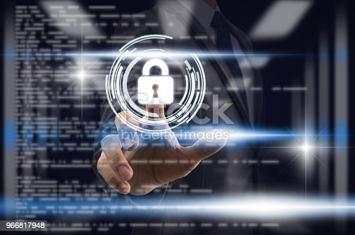 istock Businessman Fingerprint scan the smart table for unlock th screen over blurred data center server room with coding background,, Business Technology sceurity Concept. 966817948