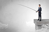 Businessman fishing nothing from the cloud with free copyspace