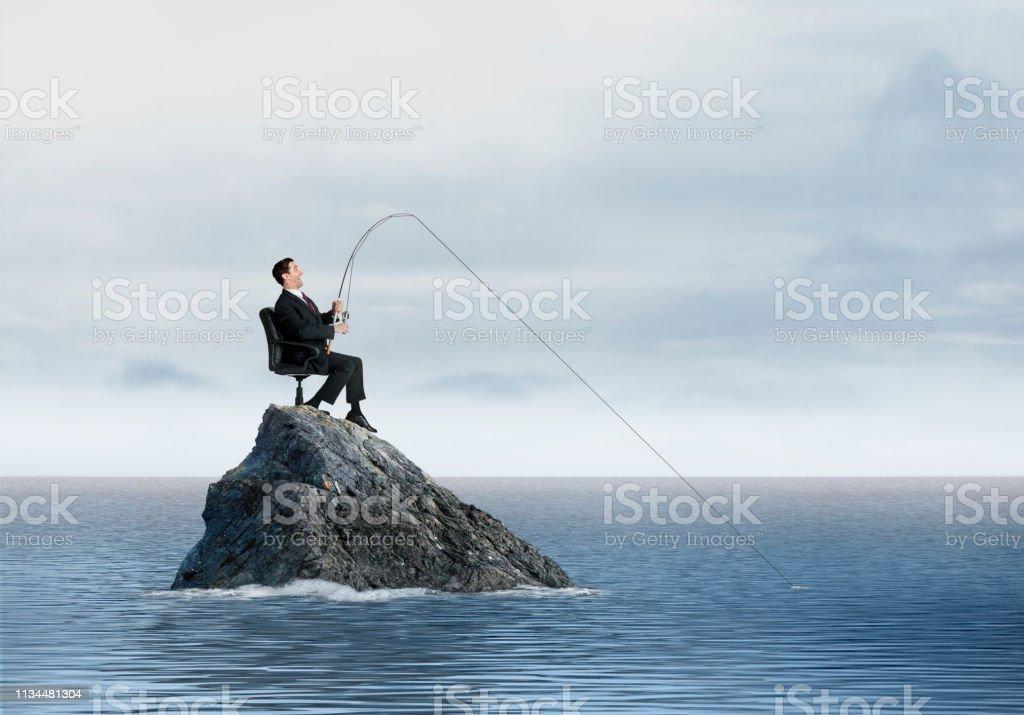 Businessman Fishing stock photo