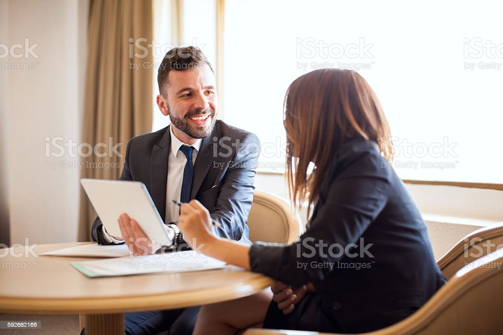 Businessman flirting with his coworker stock photo