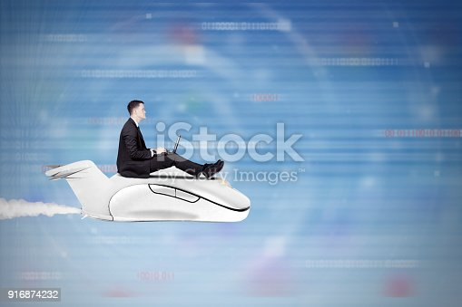 513396643 istock photo Businessman flying with computer mouse 916874232