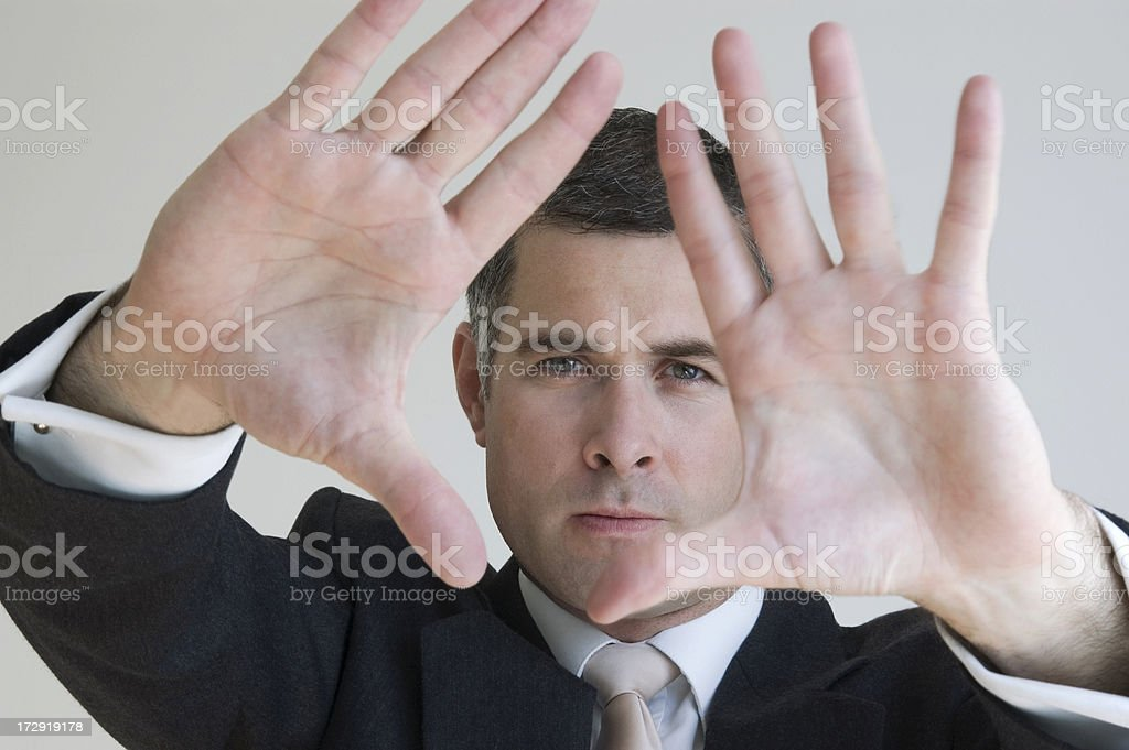 Businessman focusing stock photo