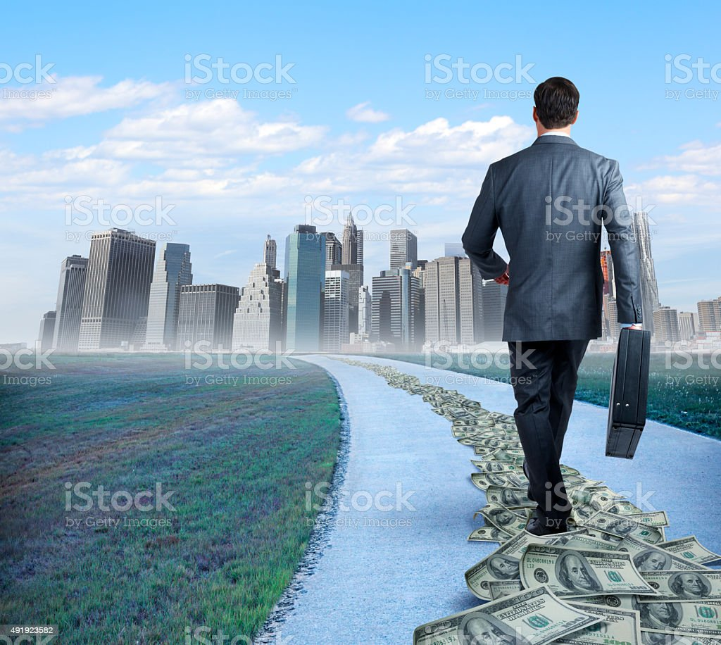 Businessman Following The Money Trail stock photo